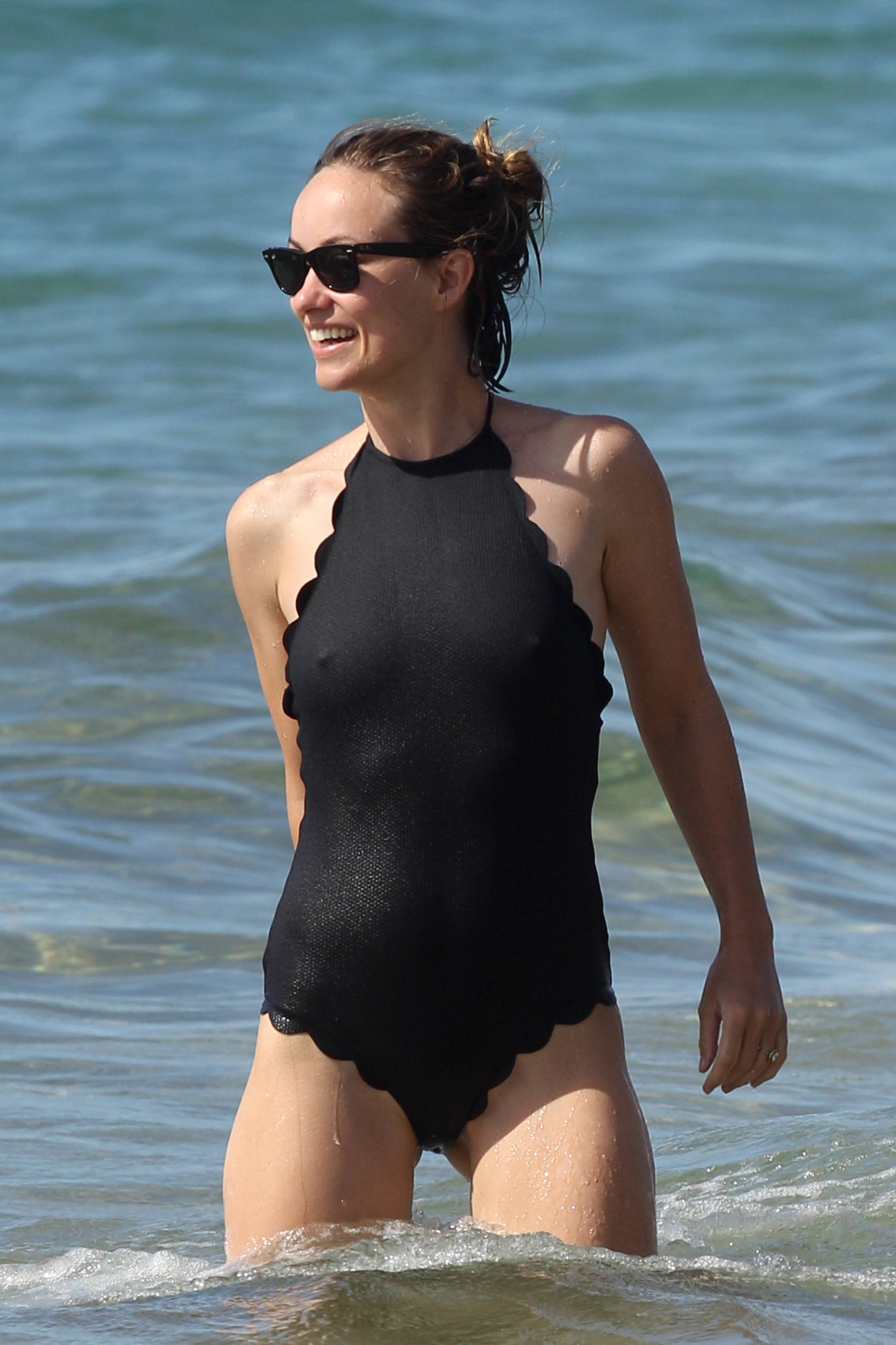 Olivia Wilde – spotted in a black swimsuit on the beach in Hawaii 11/28/17